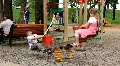 Boy and girl on seesaw HD Footage