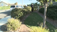 Stock Video Footage of DEA or SWAT officers with arms drawn perform a drug raid on a house.