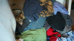 T191 doing laundry picking up dirty clothes hamper Stock Footage
