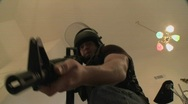 Stock Video Footage of A SWAT team with DEA officers clears a house during a drug raid and holds a
