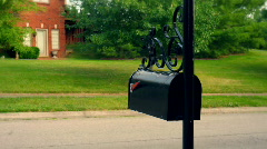 T191 mailbox redhead getting mail college student 1 Stock Footage