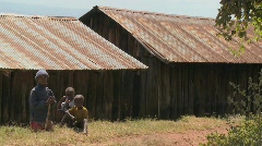 African children sit near a slum. Stock Footage