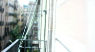 Woman looks from the balcony Stock Footage