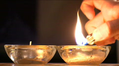 Lighting Candles with a Lighter  Stock Footage