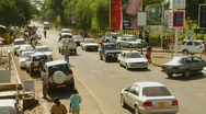 Stock Video Footage of Arusha, Tanzania with vehicle traffic on the streets.