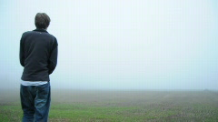 Man Walking Out Into A Big Empty Field Stock Footage