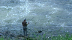 Fisherman by Flowing River - stock footage