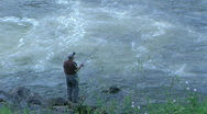 Fisherman by Flowing River Stock Footage