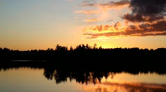 Beautiful fire sunset on forest lake Stock Footage