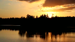 Beautiful sunset on forest lake Stock Footage