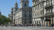 Tourists crossing the road to Parliament Square London England Stock Footage
