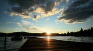 People Walking on Dock at Sunset Stock Footage