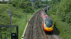 Pendolino tilting passenger train on the West Coast mainline England - stock footage
