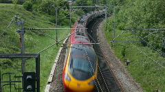 Pendolino tilting passenger train on the West Coast mainline England - stock footage
