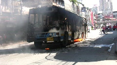 BURNING BUS in Riot Street CIVIL WAR Protest Demonstration RED SHIRT Thailand  Stock Footage