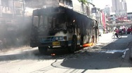 Stock Video Footage of BURNING BUS in Riot Street CIVIL WAR Protest Demonstration RED SHIRT Thailand