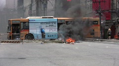 Bus burns in Bangkok Street 2010 Civil War Conflict Protest Terror Bomb  - stock footage