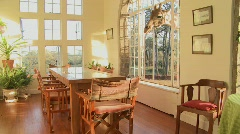 Giraffes stick their heads into the windows of an old mansion in Africa and eat - stock footage