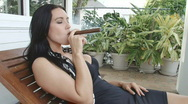 Sexy woman smoking cigar in South Beach Stock Footage