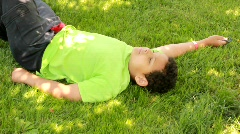 Boy resting in shade (HD) k - stock footage