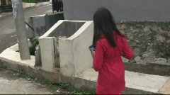 A Child Throwing Out Trash Stock Footage