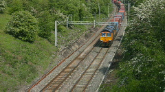 A long diesel locomotive hauled freight train, Northamptonshire England UK Stock Footage