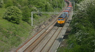 Stock Video Footage of A long diesel locomotive hauled freight train, Northamptonshire England UK