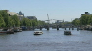 Canals, tourism, bridges, water in Amsterdam Stock Footage
