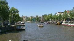 Boat full of tourists in Amsterdam, Holland Stock Footage