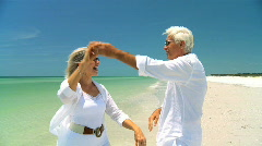 Seniors Dancing on the Beach 60FPS Stock Footage