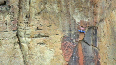 Rock Climber Reaches for Next Hand Hold at Smith Rock State Park in Oregon - stock footage