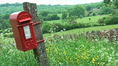 Red Post Box in the Cotswold, England Stock Footage