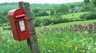 Stock Video Footage of Red Post Box in the Cotswold, England