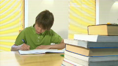 Boy studying 11 29.97fps Stock Footage