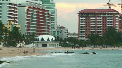 Puerto Rico - HD People at Condado La Concha Beachfront in San Juan at Sunset 2 - stock footage