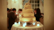 Stock Video Footage of golden wedding cake center