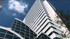 Sky Scraper - Building in Tokyo, Japan. Modern architeture. Clouds passing Stock Footage