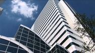 Sky Scraper - Building in Tokyo, Japan. Modern architeture. Clouds passing Stock Footage