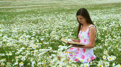 Reading books on the nature Stock Footage