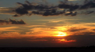 Red Sunset Behind Clouds Timelapse Stock Footage