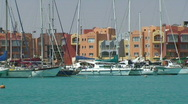 Stock Video Footage of Sailing boats in sunny harbour - zoom out