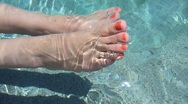 Stock Video Footage of Woman's Feet in Water