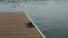 Boat tie down on Dock of Lake Stock Footage