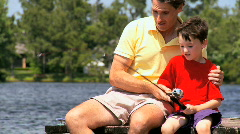 Father & Son Fishing Success Stock Footage
