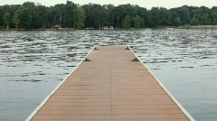 Dock with Boat in Background Pulling Tube Stock Footage