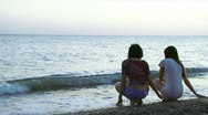 Stock Video Footage of The girls sit on the sea