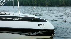 Boat floating near dock Stock Footage