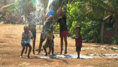 Asian Kids Playing With Water During Songkran On The Road In The Slums - stock footage