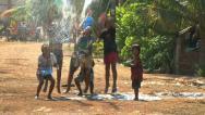 Stock Video Footage of Asian Kids Playing With Water During Songkran On The Road In The Slums