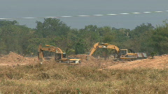 Stock Video Footage of Two Front Diggers Working In Rural Thailand